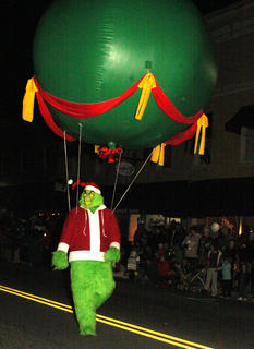 """""""You're a mean one Mr. Grinch."""" Grinch and other characters from """"Suessical the Musical"""" walked in the parade for The Stephen Foster Drama Association."""