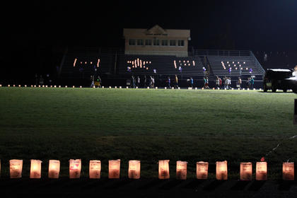 """Luminaria bags on the Bardstown High School track bleachers spell out the word """"HOPE"""" as luminaria lining the track feature the names of cancer survivors as well as people who have died of cancer at the May 13-14 Relay for Life event."""