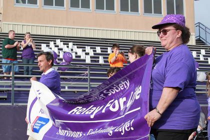 Former Bardstown mayor and cancer survivor Dick Heaton, honorary survivors chairman, and Relay for Life Chair Anita Westrup lead the Survivors' Lap at the annual Relay for Life event May 13.