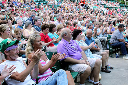 Audience members applaud the performance of Eagles cover band Hotel California  Monday night at the J. Dan Talbott Amphitheatre.