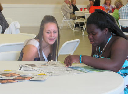 Michaela Patton, left, and Aleah Graham enjoy a moment at the Harvest Homecoming chili supper held Friday, Sept. 23, at the Bishop Auction House in Bloomfield.