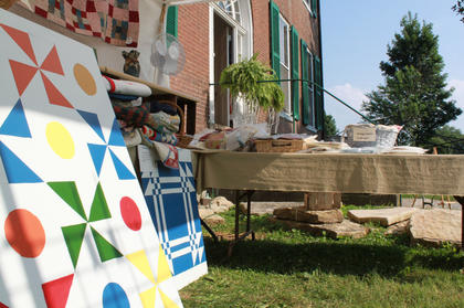 The booth of Dixie Hibbs, an organizer of the second annual Wickland Arts and Crafts Festival, sold painted quilt squares and quilts of all sizes.