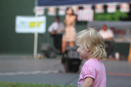 Adrianna Baker, 2, watches the competition and the crowd Monday night. Her aunt, Tammy Jo Baker, performed during the show.