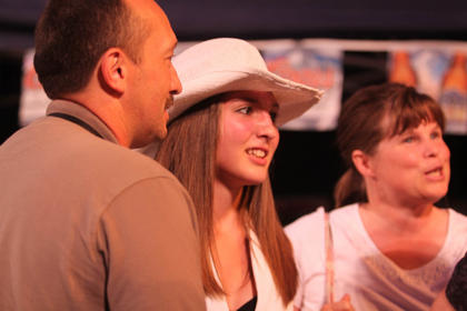 Makayla Richardson, surrounded by her mom, Joyce, and her dad, Chris, talks to people after the show.