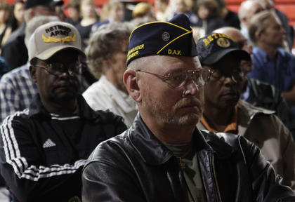 From left, veteran Earnest Brock, Vietnam veteran William Frank Judd Jr. and Desert Storm veteran Jewel Brock look on during the annual Veterans Day Ceremony at Nelson County High School Friday.