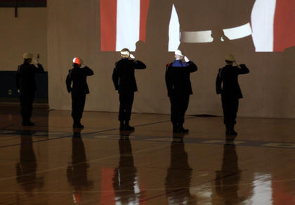 The Nelson County High School ROTC Remembrance Team salutes during a tribute to fallen veterans at the school's annual Veterans Day ceremony Friday. Veterans were invited to attend the ceremony, which included a color guard ceremony and music from the Nelson County High School band.