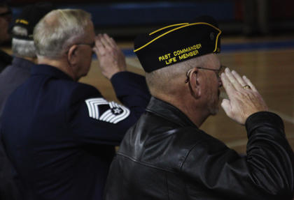 Thirty-four-year Air Force and Air National Guard veteran Frank Hall, left, and Vietnam veteran William Frank Judd Jr. salute during the annual Veterans Day ceremony at Nelson County High School Friday. Hall is a member of the Nelson County School Board.