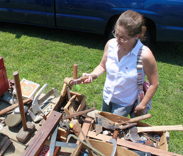 """Milissa Hilbert, Taylorsville, browses at the """"Old Tools and Rusty Crap"""" yard sale set up on the side of KY 48 each year by Gary Tichnor and Larry Inman during the Fairfield Days and Homecoming celebration."""