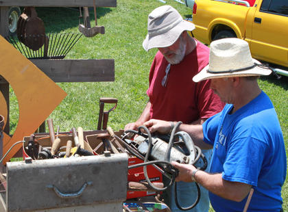 """Gary Tichnor shows off some of the """"Old Tools and Rusty Crap"""" he and Larry Inman sell at the Fairfield Days and Homecoming every year."""