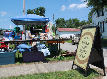 """Gary Tichnor and Larry Inman, both of Fairfield, set up a yard sale booth called """"Old Tools and Rusty Crap"""" every year at the Fairfield Days and Homecoming."""