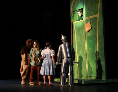After a long journey down the Yellow Brick Road, Dorothy and her friends knock on the door of Oz. David Cross portrays the gatekeeper.