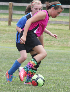 Hannah McCubbins of the U12 Nelson County Shockwave works against an opponent during play in last weekend's Bluegrass State Games.
