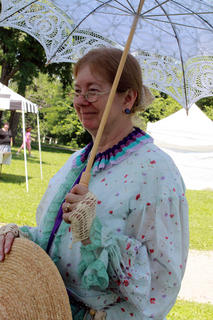 Reenactor Joan Howard, Frankfort, as Mary Todd Lincoln enjoys a musical performance at the Wickland 19th-Century Barbecue July 9. Howard has portrayed Mary Todd Lincoln alongside her husband as Abraham Lincoln since 1985.