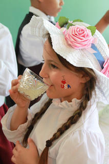 Emma Binkley, 8, drinks lemonade in old-fashioned clothes at the Wickland 19th-Century Barbecue July 9, where guests could try on period costumes, listen to music and watch a blacksmith demonstration.