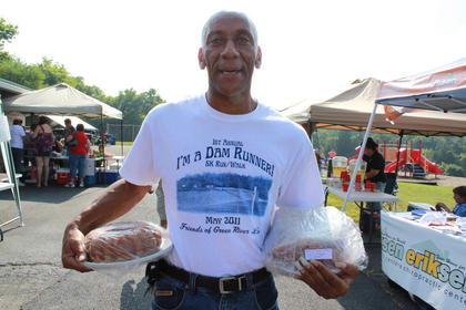 "Cecil Ellis, ""The Running Man,"" known for running dozens of miles a week around Nelson County, won two cakes in the St. Michael the Archangel Church cake walk at the Bloomfield Picnic in the Park July 9, 2011."