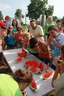 People of all ages competed in a watermelon eating contest while onlookers cheered them on at the Bloomfield Picnic in the Park July 9, 2011.