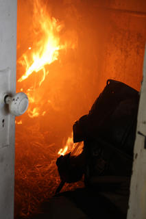 Firefighters breathed in fresh air through face masks as they watched the fire spread across the kitchen ceiling in a house at 715 N. Third St. As part of their training, they learned how a fire spreads, and how to trace the source of a fire.
