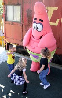 Three-year-olds Jose Varguez of Radcliff, Cheyenne Denton of Stanford, and Ashlyn Edge of Ohio County dance with Patrick the starfish at the Kentucky Railway Museum in New Haven Sept. 25.