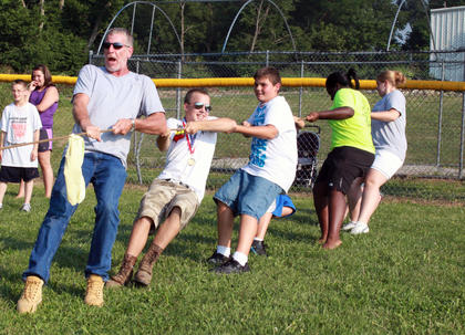 Tug-of-war was one of four different old-fashioned games adults and children alike were invited to participate in at the Bloomfield Picnic in the Park July 9, 2011.