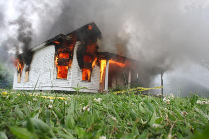 A house was set fully ablaze after smaller fires were set repeatedly in each room for training May 12.