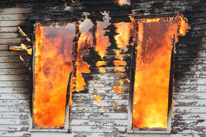 Flames flickered from the windows of the house at 715 N. Third St. as it burned to the ground. It was allowed to burn after the day was spent lighting and extinguishing smaller fires for training.