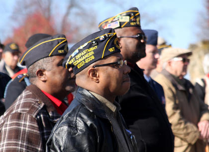 The crowd looks on as Doug Alexander, Nelson County Sheriff's Department chaplain, leads a prayer at the Bardstown Veterans Day Ceremony at Veterans Park on East Broadway Friday morning. Pictured are, from left, Bryan Rogers, Army veteran and member of American Legion Post 167; Sidney Shouse, veteran of the 801st maintenance at Ft. Campbell; and Donald Crume, retired U.S. Army veteran.