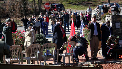 """A crowd gathered at Veterans Park in Bardstown Nov. 11, 2011 for Veterans Day. Saluting the flag in the foreground are, from left, keynote speaker Brig. Gen. Thomas Raymond Ice; Col. James Gibson, who served in the Berlin Airlift and has received three Purple Hearts; Erwin """"Russ"""" Marlowe, U.S. Army and Army National Guard veteran; Robert Bearce, a Marine Corps veteran who flew over Vietnam; American Legion Post 121 Commander Peter Trzop; and Post 167 Commander Gregory T. Rogers."""