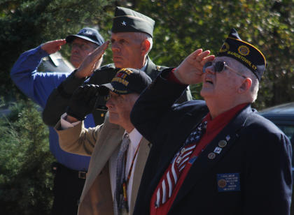 """Saluting the flag at the 2011 Bardstown Veterans Day Ceremony are, from left, Nelson County Sheriff's Department Chaplain Doug Alexander, keynote speaker Brig. Gen. Thomas Raymond Ice, Col. James Gibson, who served in the Berlin Airlift and has received three Purple Hearts, and Erwin """"Russ"""" Marlowe, U.S. Army and Army National Guard veteran."""