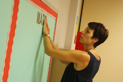 Gia Paolina, a fifth grade teacher, hangs decorations in her classroom at Bardstown Elementary. Paolina said this will be her first year as a full-time teacher in Bardstown City Schools. She noted that she completed her student teaching at Bardstown Elementary and Bardstown Primary.