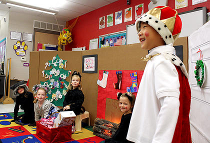 """Kindergartner Samuel Sanders performs as Old King Cole as a mama kitten and her Three Little Kittens who lost their mittens look on during a performance of """"The Christmas Box"""" in the class of Kristen O'Bryan at Bardstown Primary School Thursday. The kittens are, from left: Elizabeth Johnson, Hope Lyvers, McKenzie Hill and Alaina Walton."""