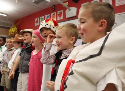 """Cade Boone, """"Humpty Dumpty,"""" right, and Landen Lucas, the """"Ten o' Clock Scholar,"""" second to right, sing a Christmas song alongside their fellow kindergartners following a performance of """"The Christmas Box"""" in the class of Kristen O'Bryan at Bardstown Primary School Thursday."""