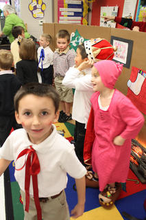 """Jason Leslie, also known as Little Tommy Tucker, relaxes after a performance of """"The Christmas Box"""" alongside his classmates in the kindergarten class of Kristen O'Bryan at Bardstown Primary School Thursday."""