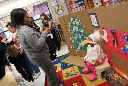 """Elizabeth Bell-Young takes a photo of her daughter, Saneea Farris, who played Mother Goose in """"The Christmas Box,"""" a play performed by the kindergarten class of Kristen O'Bryan at Bardstown Primary School Dec. 15."""