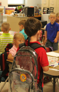 A student enters his new class for the first time during the first day of school at Foster Heights Elementary School Aug. 3.