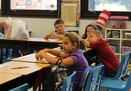 Students wait for their first lesson in Lacy Hatfield's fourth-grade science class on the first day of the 2011-2012 school year at Foster Heights Elementary School Aug. 3.