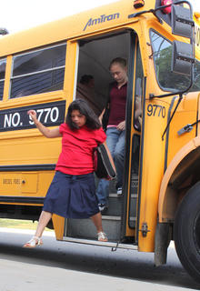 Third-grader Sianna Vargas gets off the bus at Foster Heights Elementary the first day of school.