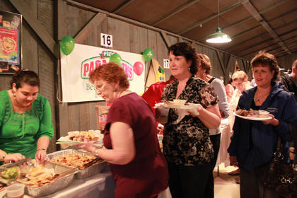 Dulce Salas serves samples from Rincon Mexican Restaurant to Barbra Bailey of Bardstown, Marie Clark of Cox's Creek and Judy Underwood of Bardstown.