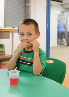 Dylan Coulter, 4, Bloomfield, enjoys Kool-Aid in the cafeteria of the new Nelson County Early Learning Center.