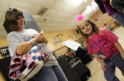 """Kristie Day, 3, Bardstown, wears a """"Hope for Hannah"""" shirt as Crissy Smith, Bardstown, looks on at Friday's Hope for Hannah benefit at the American Legion Post 121 hall. Proceeds from the benefit will help cover ongoing medical costs for 14-year-old Hannah Hamric, who remains in a coma at the Home of the Innocents in Louisville after being hit by a truck in Bardstown Jan. 29."""