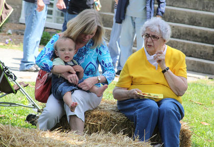 Hazel O'Bryan, Balltown, right, sits with neighbor Cindy Weakley and her 1-year-old grandson, Charlie Askelson, at the herb festival.