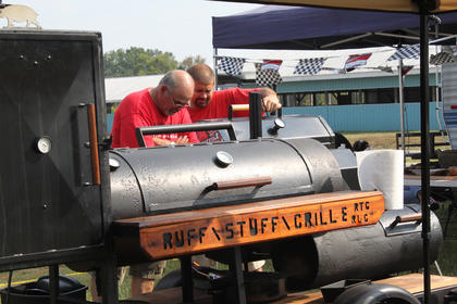 Ronnie Goodman, left, and son, Chad, Glendale, formed the Triple A BBQ team at the Bourbon City BBQ Festival Cook-off Sept. 3, 2011. Their booth was right next door to son and brother, Jay Goodman, whose Old Smokin' Horse Grille won prizes along with Triple A.