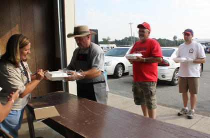 Pam Gover, one of the organizers for the first-ever Bourbon City BBQ Festival Sept. 2-3, accepts barbecue chicken turn-ins from the 14 teams that competed in the cook-off Saturday.