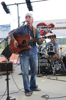 """E.J. Norsworthy, Murray, sang """"If Heaven Wasn't So Far Away"""" and original song """"When They Layed Him in the Grave"""" at the Texaco Country Showdown state finals at the Nelson County Fairgrounds Sept. 3, 2011."""