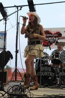 """Makayla Richardson represented WBRT of Bardstown at the Texaco Country Showdown state finals at the Nelson County Fairgrounds Saturday night. Richardson sang an original song, """"You Better Run,"""" and """"Flat on the Floor."""" Emily Kinner, Huntington, W.V., took first place."""