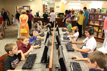 Children were already enjoying the computers at the New Haven Library Branch during its grand opening celebration 12-2 p.m. May 6.