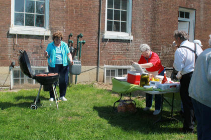 Hamburgers and hotdogs were available at the festival. Clara Fulkerson and Dixie Hibbs were among those cooking and serving food.