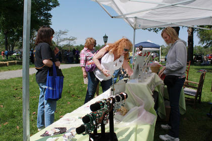 Daniela Mouser offered crystal and gemstone jewelry for sale at the festival. Tammy Mudd, left, and Claudia Popplewell check out the items.