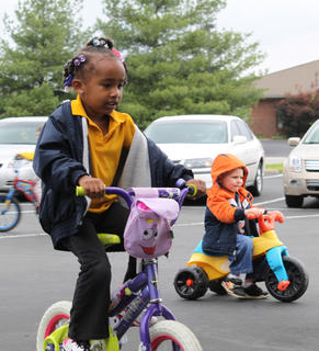 Nariyah Crowe, 4, rides her bike May 4 at Little Angels Primary House's annual Trike-a-thon, a fundraiser for St. Jude Children's Hospital. Participating students collect donations from family and friends and then get to ride their bikes and trikes for an hour of the school day.