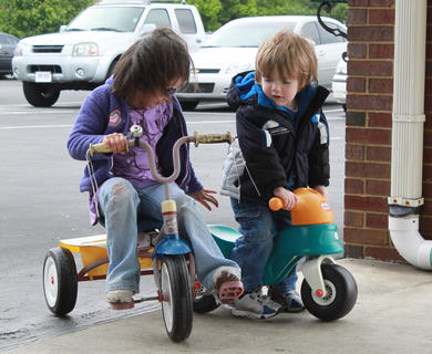 Brandy Coomes, 4, and Payne Pence, 3, handle a minor collision at Little Angels Primary House's annual fundraiser Trike-a-thon for St. Jude Children's Hospital May 4.