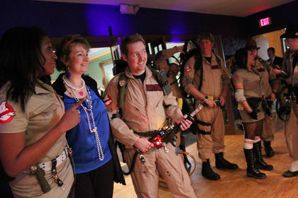 Ghostbusters pose with Lynne Grant.